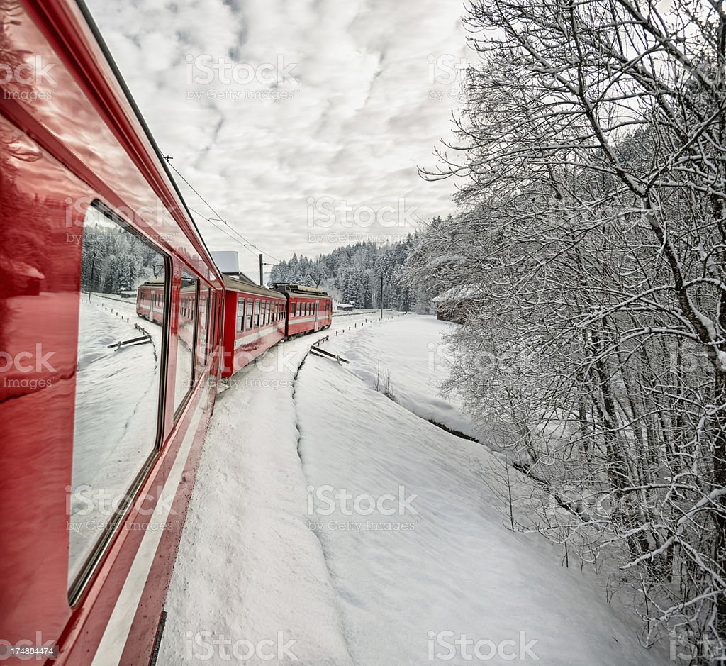Appenzeller Bahnen train in wonderful Swiss winter landscape royalty-free stock photo