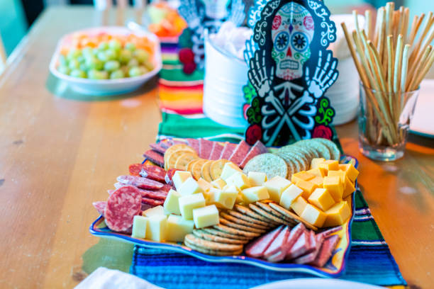 appetiser trays on the table with sarape blanket - appetiser stock photos and pictures