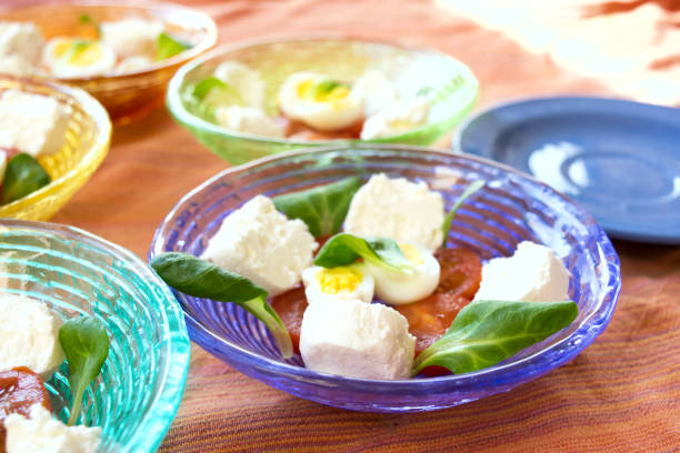 appetiser with tomatoes cheese and eggs stock photo