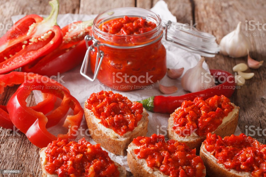 Appetizer ajvar from peppers with garlic close-up. horizontal stock photo