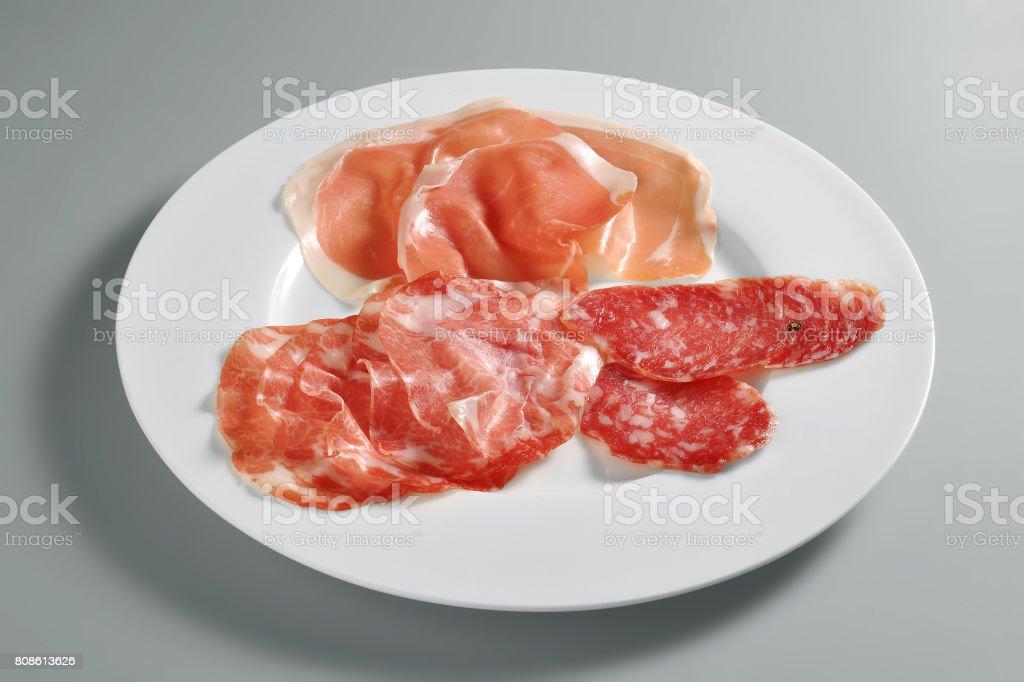 Appetizer dish with mixed salami stock photo