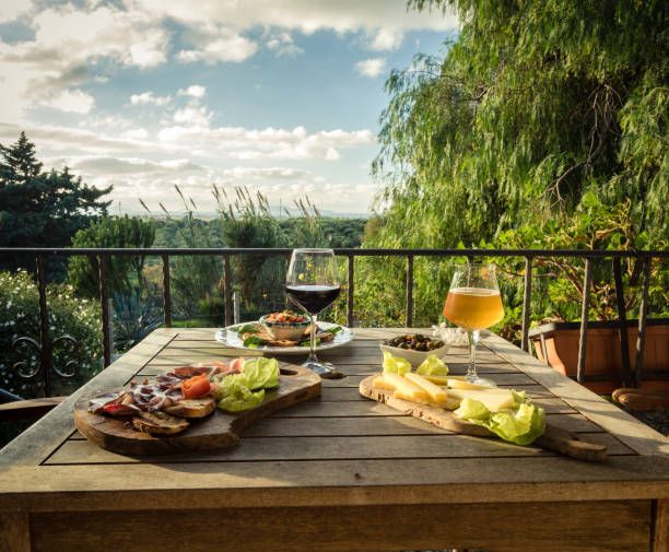 Appetizer for two on a terrace and landscape view. stock photo