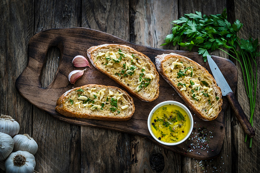 Appetizer: garlic bread on rustic wooden table