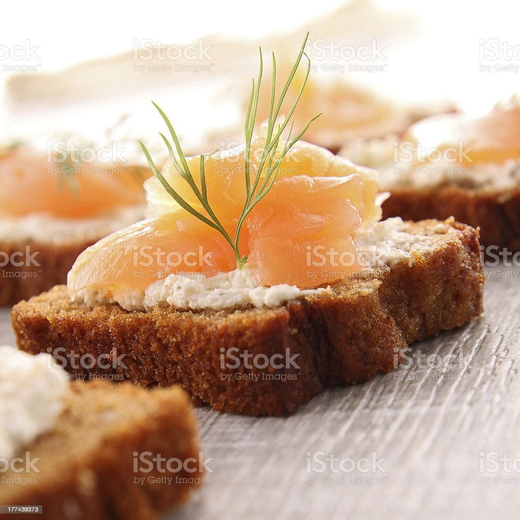 appetizer, gingerbread with cream and salmon stock photo