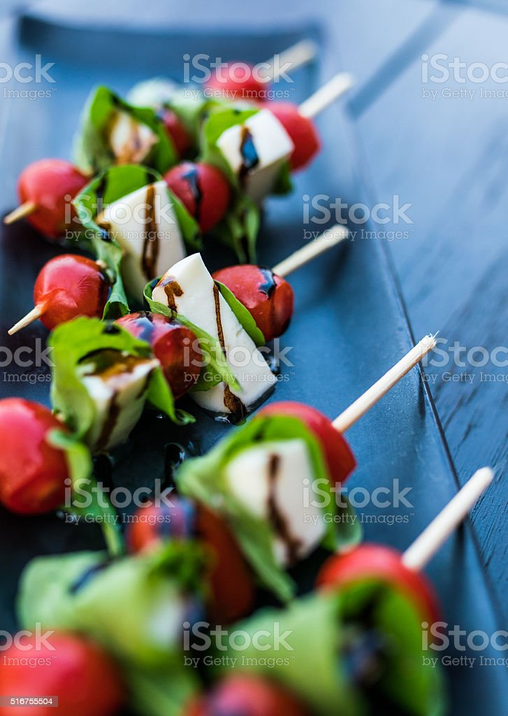 appetizer of cherry tomatoes and mozzarella cheese stock photo