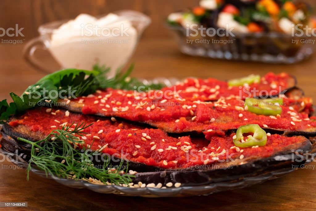 Appetizer of eggplant with a sharp taste of adjika and bitter pepper,...