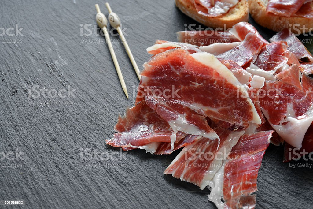 appetizer of ham Serrano with bread roasted stock photo