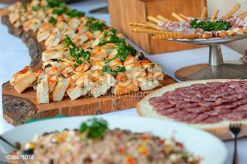 istock Appetizer of savory pizzas and other salami in a wedding party 1038671018