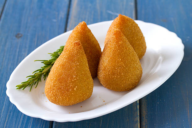 appetizer on plate - coxinha stock photos and pictures