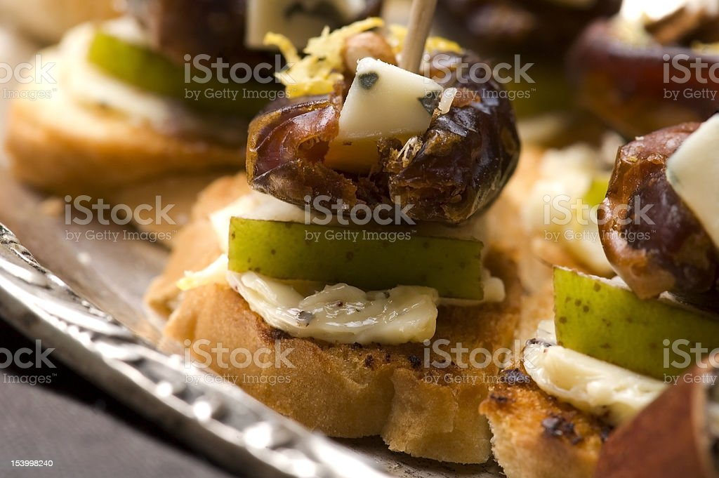 Appetizer Plate with Dactyl, Pecan nuts and Cheese royalty-free stock photo