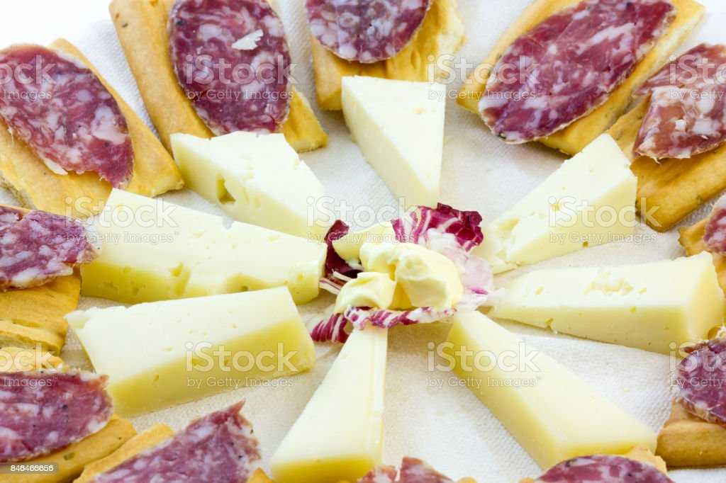 Appetizer with cheese and Italian salami stock photo