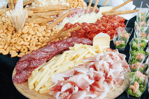 appetizers bread meats and cheeses stock photo