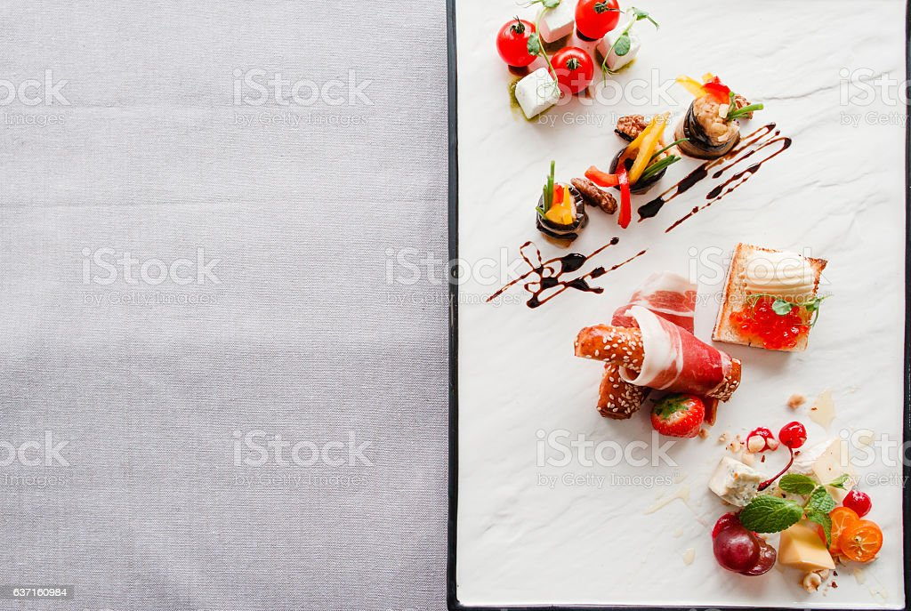 Appetizers mix flat lay, free space for text stock photo