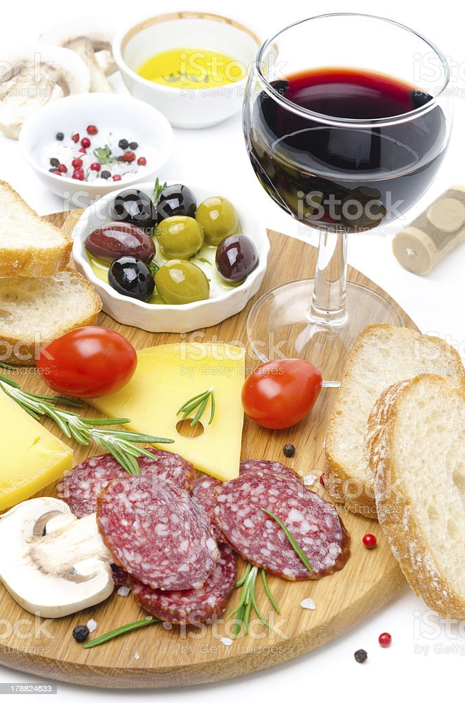 appetizers - salami, cheese, bread, olives, tomatoes and wine royalty-free stock photo