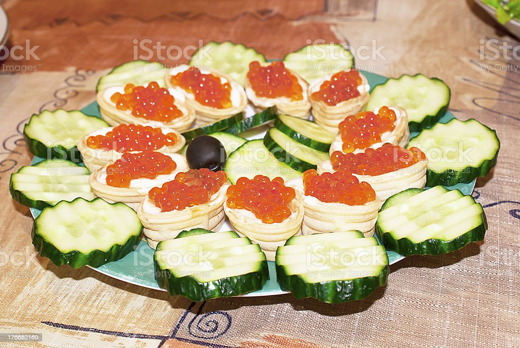Appetizers with red caviar and a cucumbe royalty-free stock photo