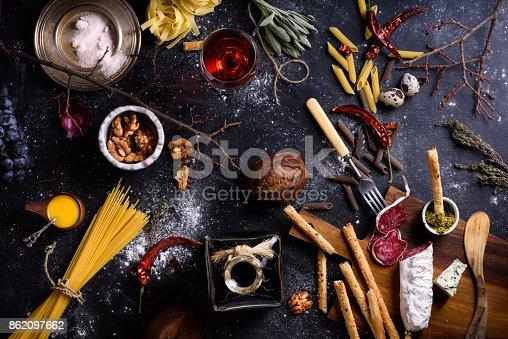 istock Appetizersalami and pasta.Italian cuisine ingredients.Top view. 862097662