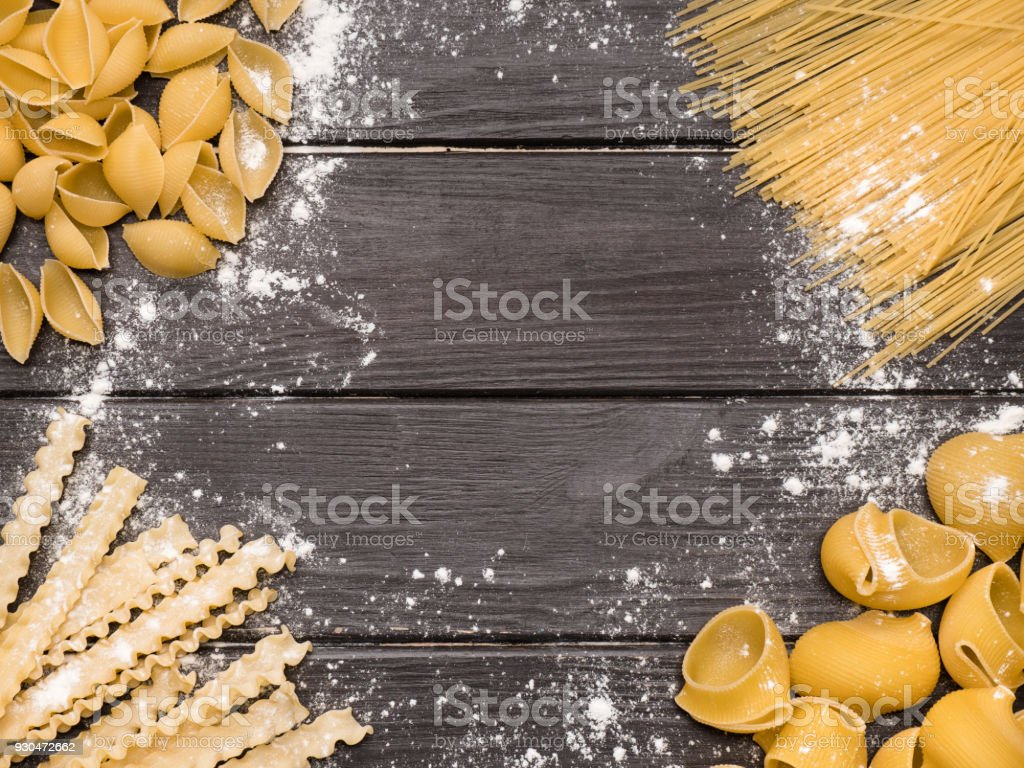 appetizing assorted pasta on vintage wooden background stock photo