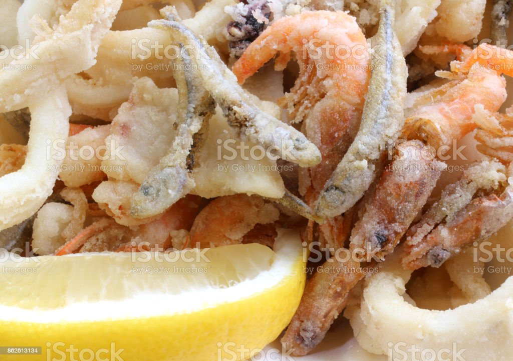 appetizing background of many fried fish with shrimp in a pan an stock photo