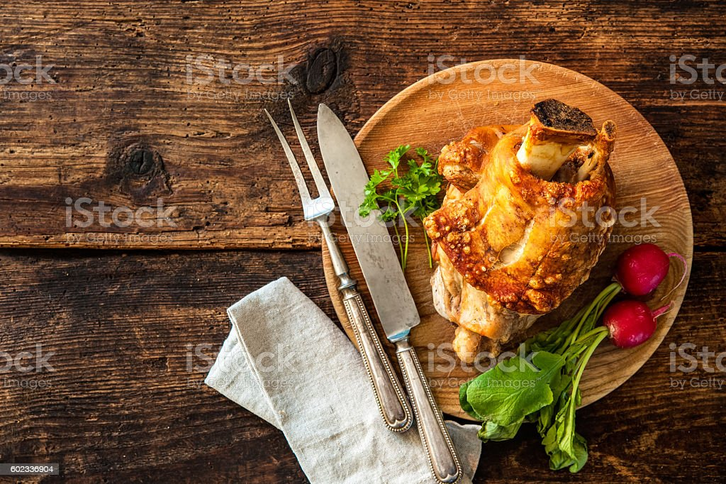 Appetizing Bavarian grilled pork knuckle stock photo