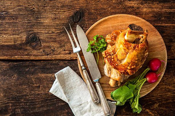 appetizing bavarian grilled pork knuckle - bavaria porzellan stock-fotos und bilder