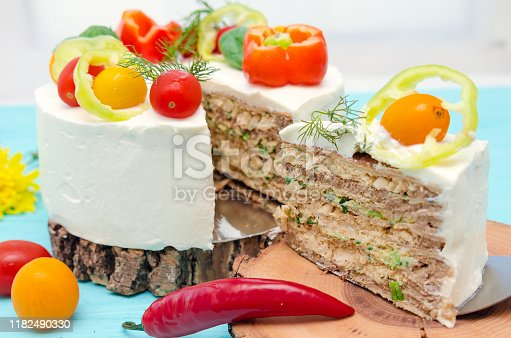 istock Appetizing cake with chicken meat, eggs and salad. Snack unsweetened cake. 1182490330