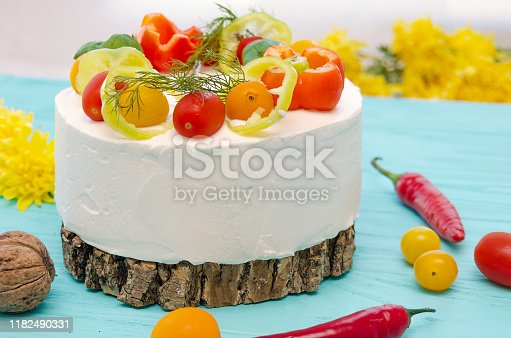 istock Appetizing cake with chicken meat, eggs and salad. Snack unsweetened cake. 1182490331