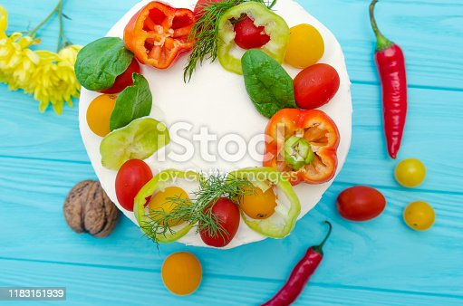 istock Appetizing cake with chicken meat, eggs and salad. Snack unsweetened cake. 1183151939
