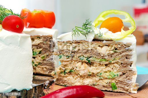 istock Appetizing cake with chicken meat, eggs and salad. Snack unsweetened cake. 1183151943