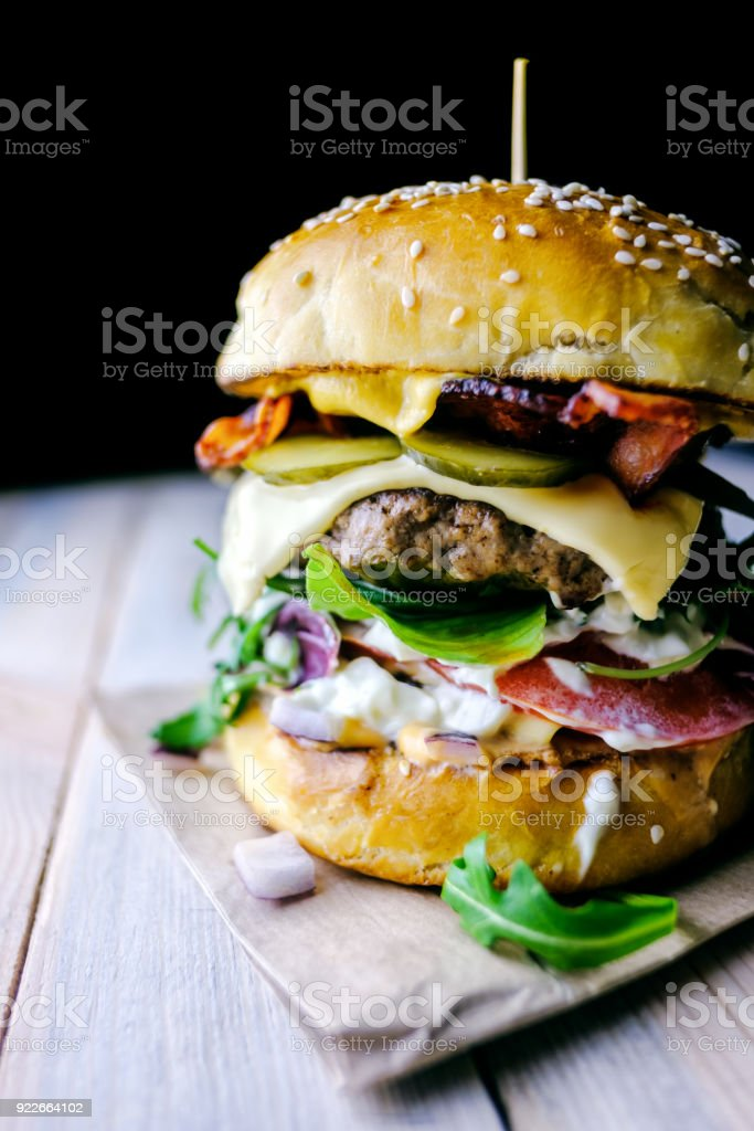 Appetizing cheeseburger on wooden table. stock photo