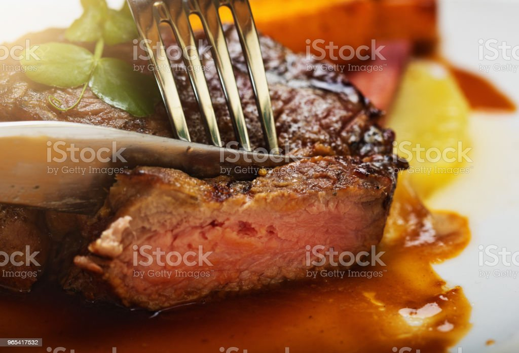 Appetizing fillet steak being sliced zbiór zdjęć royalty-free