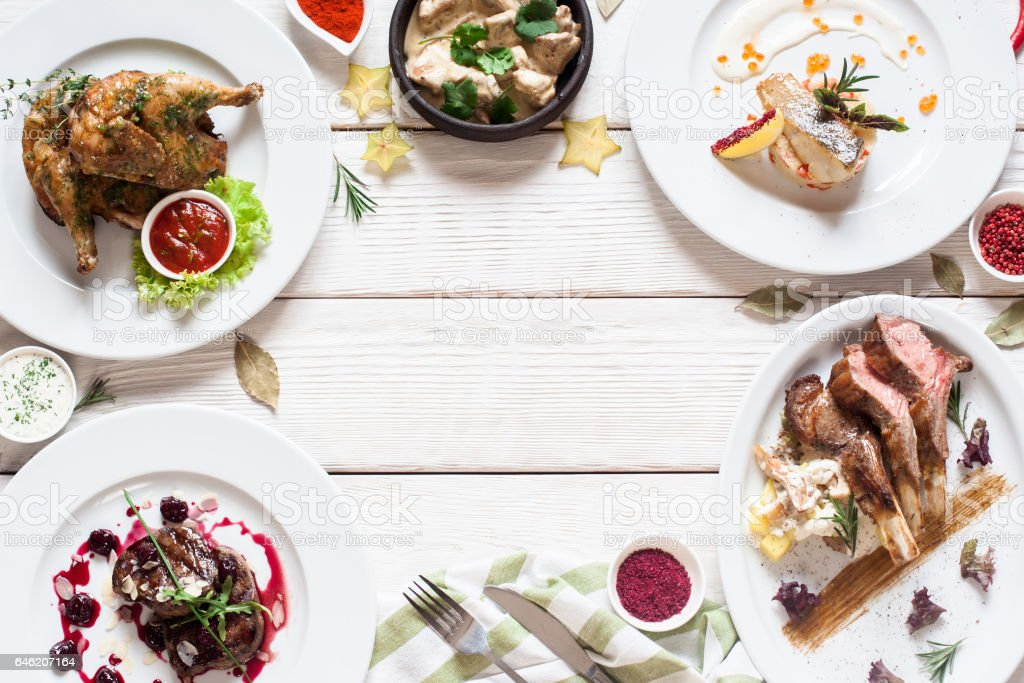 Appetizing frame of restaurant meals flat lay stock photo