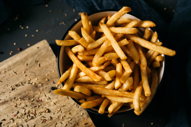 appetizing french fries in a bowl stock photo