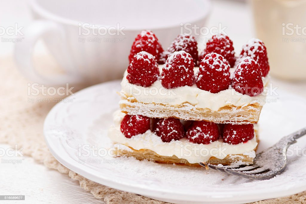 Appetizing french millefeuilles raspberry dessert stock photo