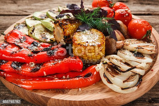 655793486 istock photo Appetizing grilled vegetables on wooden platter 655793782