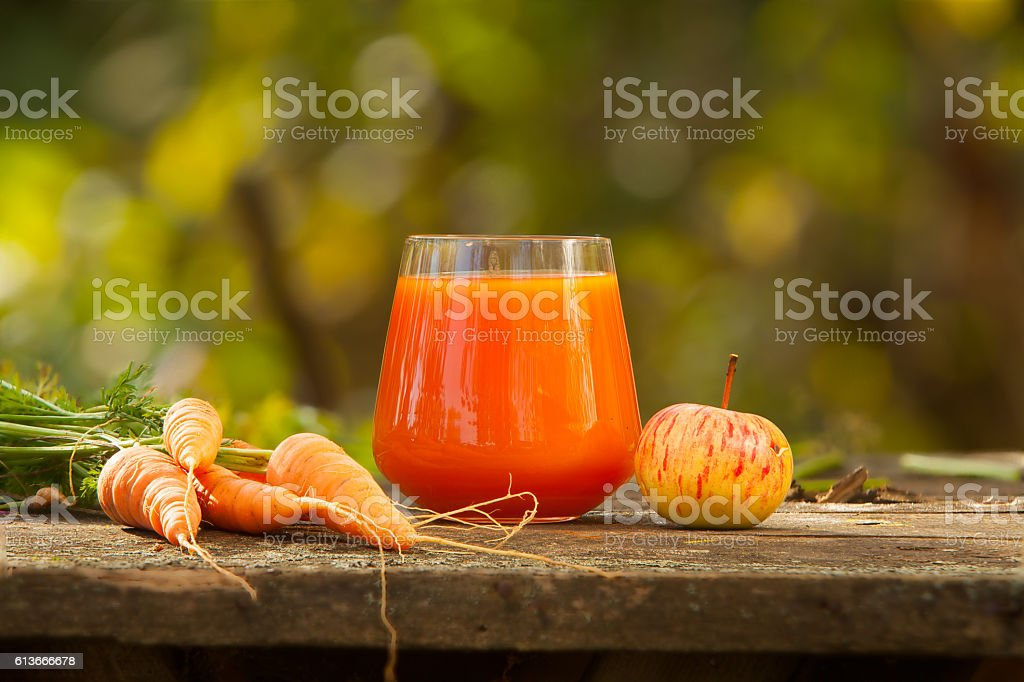 appetizing juice from carrots and apples stock photo