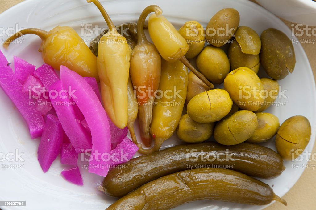 Appetizing marinated vegetables on a white plate royalty-free stock photo