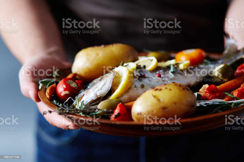 Appetizing Meal With Baked Fish stock photo