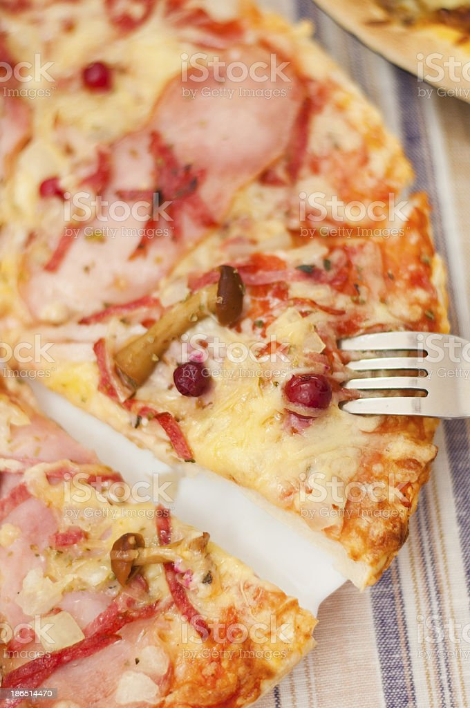 Appetizing pizza with mushrooms and ham royalty-free stock photo
