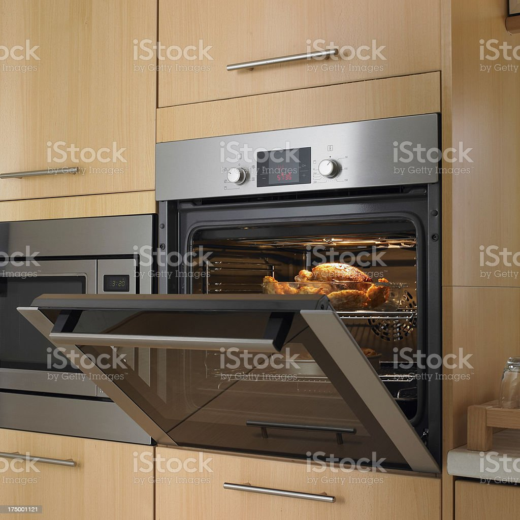 Appetizing roast turkey in the oven for thanksgiving day stock photo