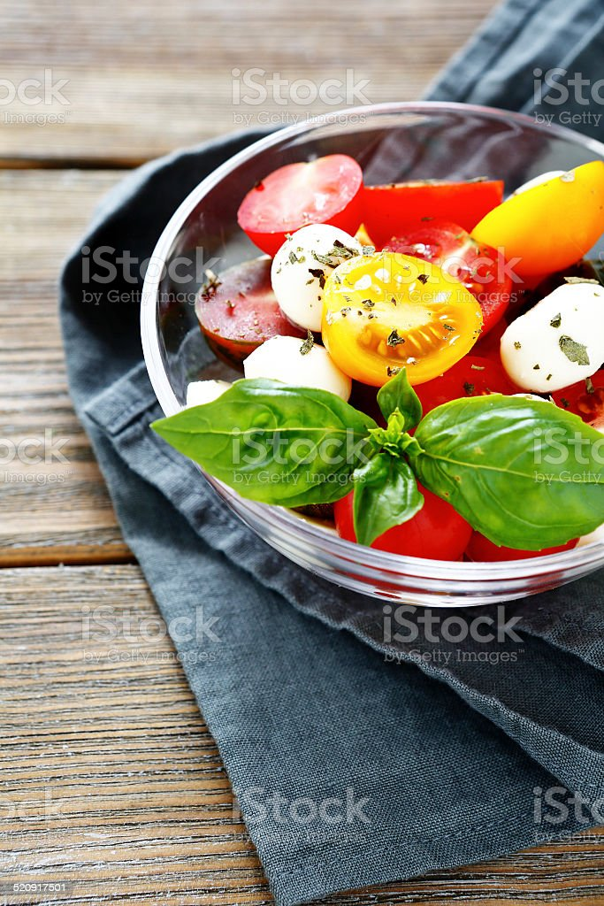 appetizing salad with tomatoes in bowl stock photo
