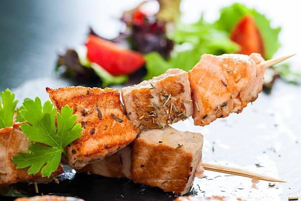 Appetizing salmon and tuna skewer. stock photo