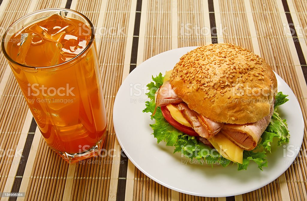Appetizing sandwich and glass of orange juice royalty-free stock photo