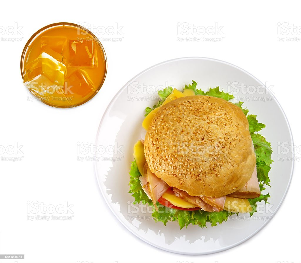 Appetizing sandwich and glass of orange juice stock photo