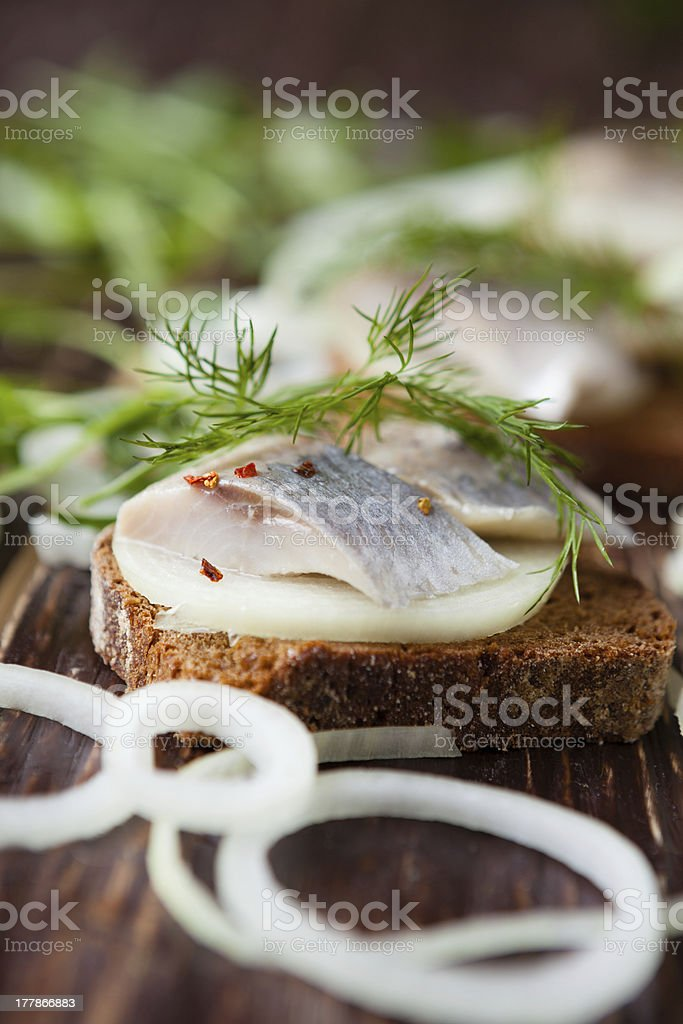 appetizing sandwich with marinated herring royalty-free stock photo