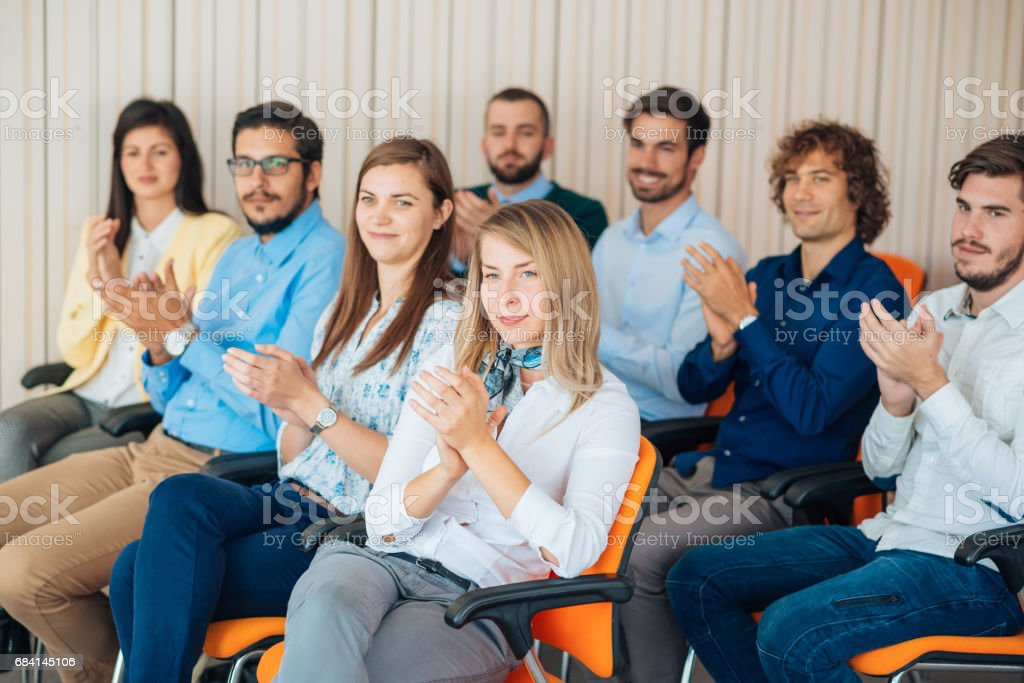 Applauding and ovations as sign of satisfaction royalty free stockfoto