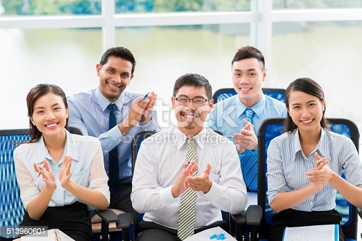 862720340 istock photo Applauding business people 513960601