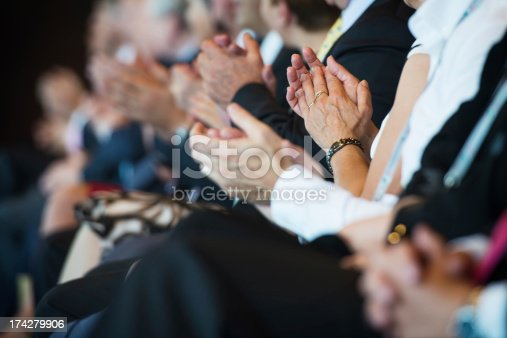 511305456 istock photo Applauding businesspeople in a row 174279906