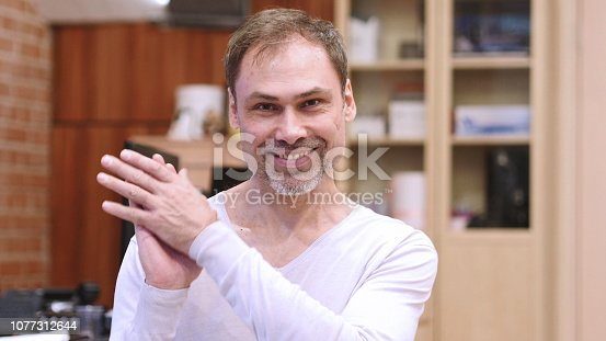 888751614 istock photo Applauding, Clapping Middle Age Man at Work 1077312644