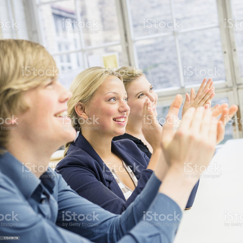Applauding during a business meeting royalty-free stock photo