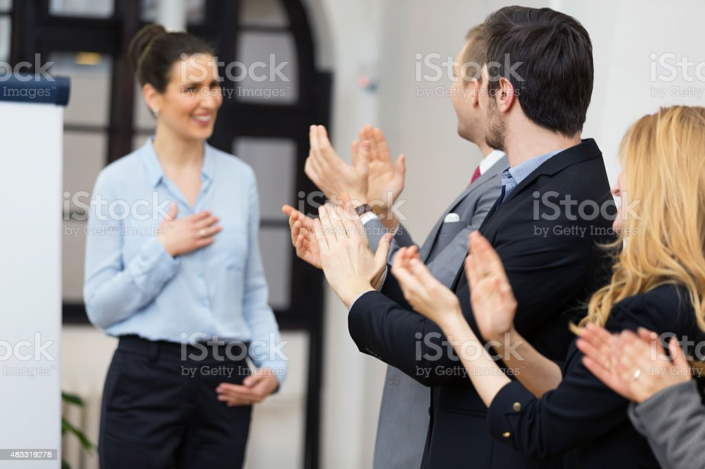 Applauding fsuccessful presentationor stock photo